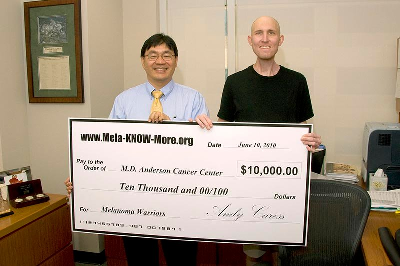 Andy presents check to Dr. Patrick Hwu at M.D. Anderson Cancer Center