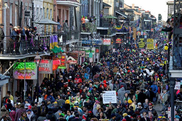 Revelers pack Bourbon Street beneath the balcony of the Royal Sonesta Hotel in New Orleans on Mardi Gras day in the French Quarter, Tuesday, Feb. 17, 2015. (AP Photo/Gerald Herbert)
